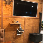 Ski Chalet Backdrop with Woodstove - Prop For Hire